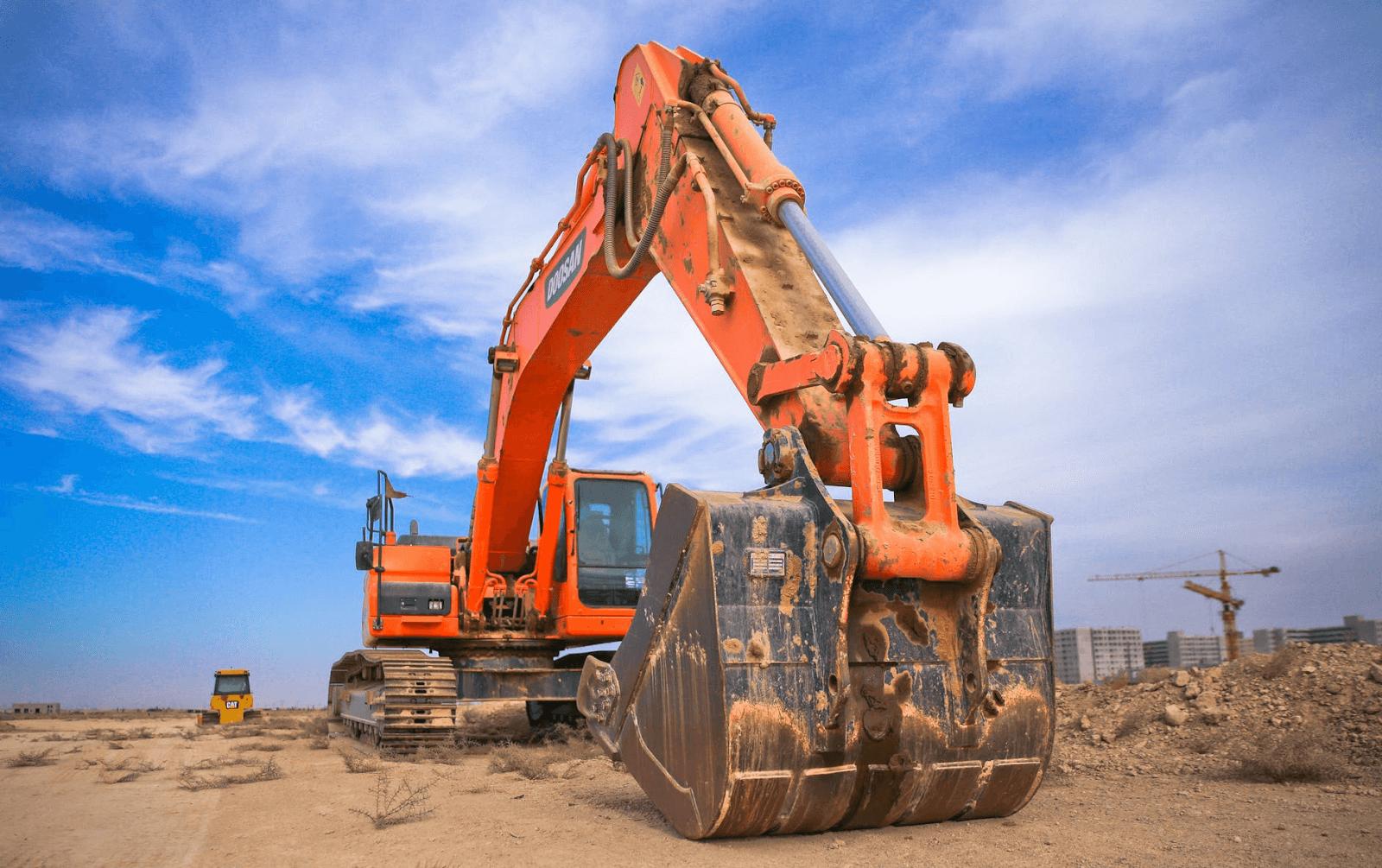 photo of an orange excavator